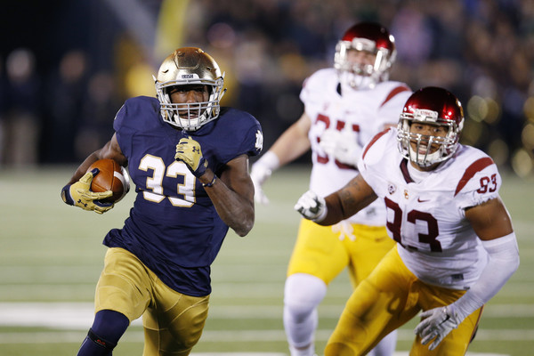 Josh Adams takes off against USC